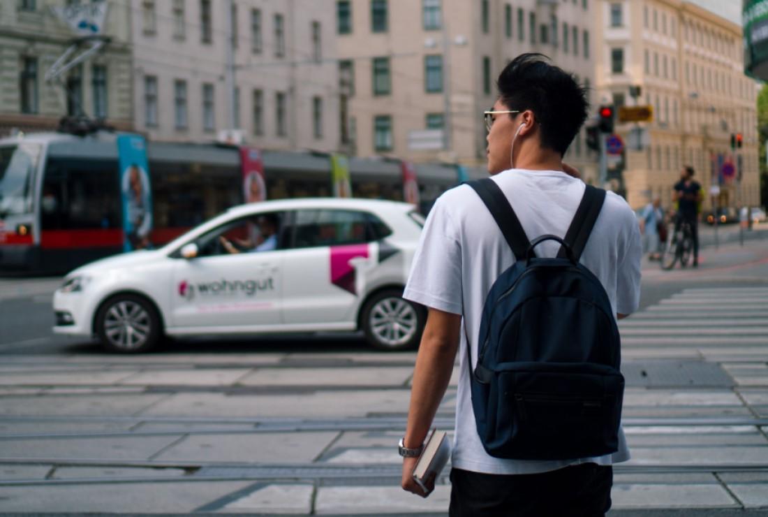 Pedestrian, Car and Tram